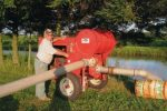 andy-on-his-farm-posing-with-irrigation-plumbing