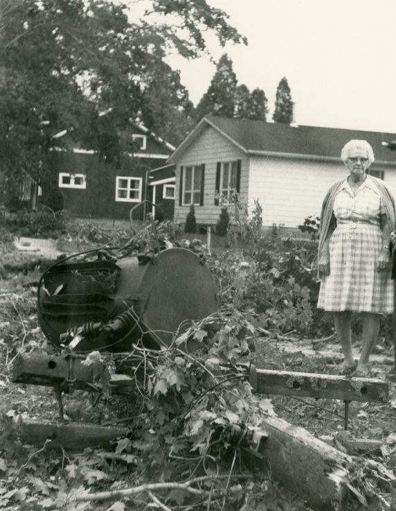 Woman Surrounded by Tornado Damage