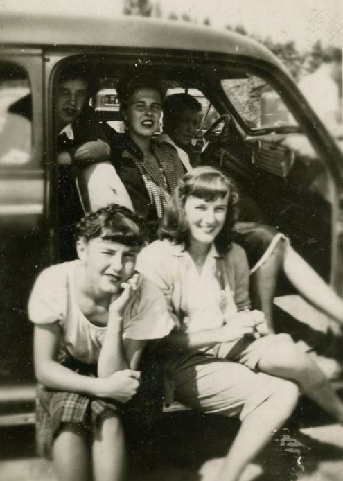 Four Farmerettes sitting in car at picnic at Reforestry Station, 1946 (2017.3.1)