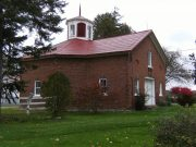 Culver family's hexagonal brick barn with red roof and hexagonal-shaped steeple