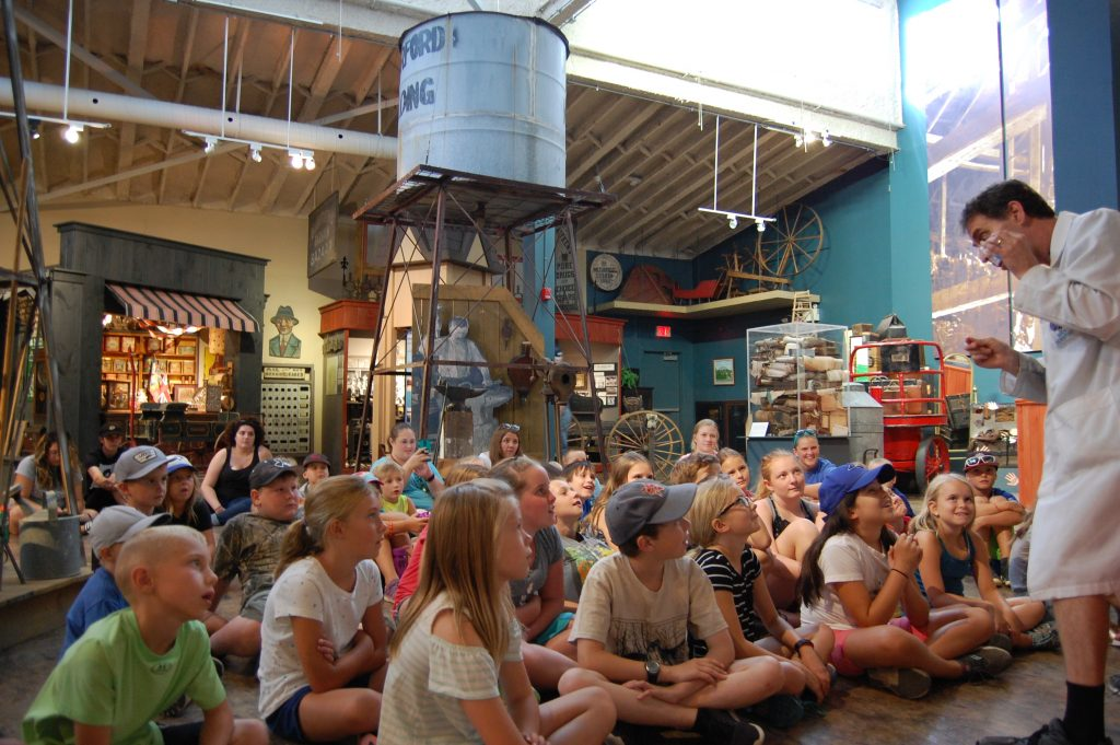 Crowd of children watching the Mad Scientist perform in WHAM's main gallery.