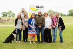 dave-reid-and-his-mentees-standing-in-front-of-an-alus-banner